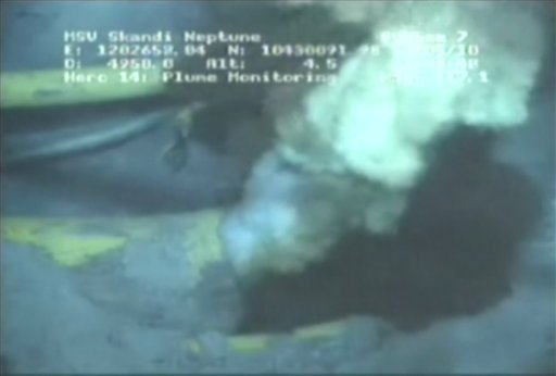 This image from a video released by BP PLC shows oil and gas spewing from a yellowish, broken pipe 5,000 feet below the surface.  (AP Photo/BP PLC, File)