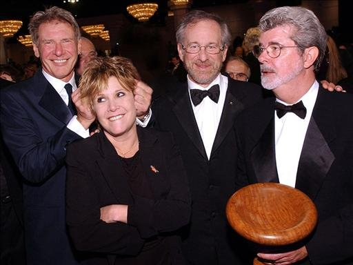 In this 2002 photo, Harrison Ford, Carrie Fisher, Steven Spielberg and George Lucas (l-r), at BAFTA/LA 11th Annual Britannia Awards, in Beverly Hills, California.