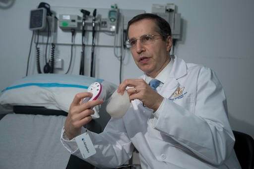 In this Thursday, Oct. 20, 2016, photo, Dr. Jeffrey Ascherman, chief of the Division of Plastic Surgery and professor of surgery at NewYork-Presbyterian/Columbia University Medical Center, holds an AeroForm kit.