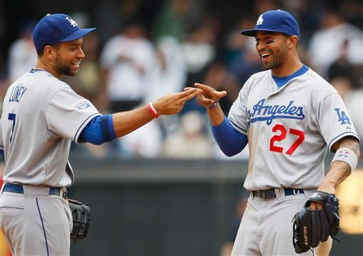 Los Angeles Dodgers' Matt Kemp, right, and James Loney congratulates each other after the Dodgers 1-0 victory over the San Diego Padres in a baseball game Sunday, May 16, 2010 in San Diego. (AP Photo/Lenny Ignelzi)