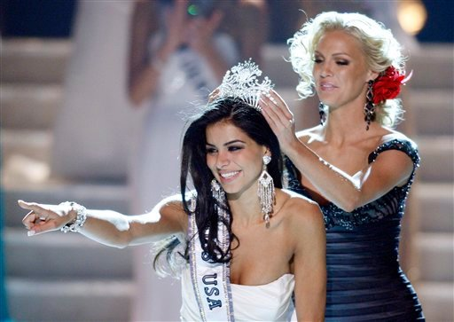 Miss Michigan Rima Fakih reacts as she is crowned Miss USA 2010 Sunday, May 16, 2010 in Las Vegas. (AP Photo/Isaac Brekken)