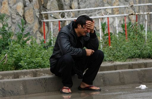 An unidentified man grieves outside the airport terminal in Kabul, upon receiving the news of the crash of a plane carrying his relative near the Salang Pass, north of Kabul, Afghanistan, Monday, May 17, 2010. (AP Photo/Saurabh Das)