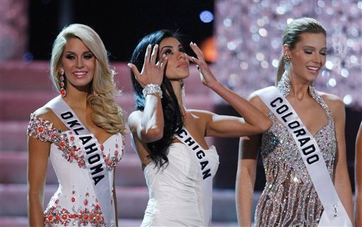 Miss Michigan Rima Fakih, center, with contestants Morgan Elizabeth Woolard, left, and Jessica Hartman during the Miss USA 2010 pageant Sunday, May 16, 2010 in Las Vegas. Fakih was later crowned Miss USA. (AP Photo/Isaac Brekken)