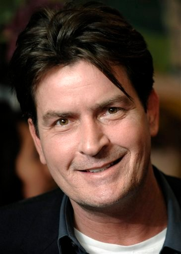 "FILE - This Jan. 28, 2009 file photo shows Charlie Sheen in Los Angeles. A statement released by Sheen's publicist Monday, May 17, 2010, said the actor had a new ""Two and Half Men"" contract."