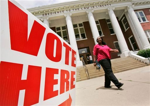 County employee Shericka Montgomery walks from the Crittenden County Court House in Marion, Ark., Monday, May 17, 2010. The building is one of the polling places in Arkansas' May 18 party primary elections. (AP Photo/Danny Johnston)