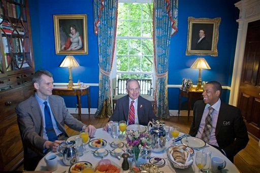 """New York City Mayor Michael Bloomberg, center, new New Jersey Nets NBA basketball team majority owner Mikhail Prokhorov, left, and Nets co-owner Shawn """"JAY-Z"""" Carter, right, have breakfast at Gracie Mansion in New York."""