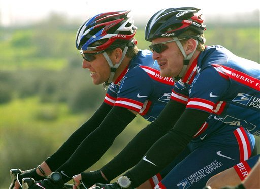 This Feb. 19, 2004, file photo shows Lance Armstrong, left, and Floyd Landis, riding side-by-side during the second stage of the 5-day Tour of the Algarve cycling race in Algarve, southern Portugal. (AP Photo/Miguel Riopa, pool, File)