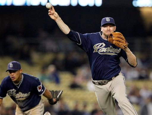 San Diego Padres third baseman Chase Headley throws out the Los Angeles Dodgers' Jamey Carroll on ground ball to end the seventh inning of their baseball game, Wednesday, May 19, 2010, in Los Angeles. (AP Photo/Alex Gallardo)