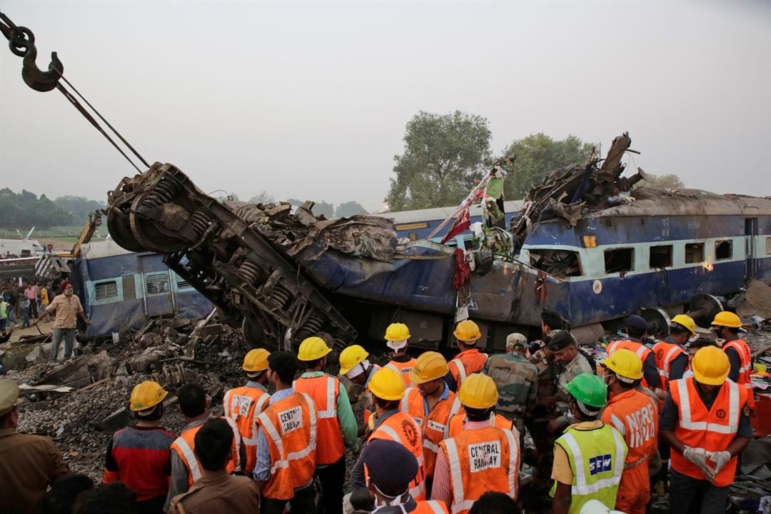 Rescuers search among the debris after 14 coaches of an overnight passenger train rolled off the track near Pukhrayan village Kanpur Dehat district, Uttar Pradesh state, India Nov. 20, 2016. (AP Photo/Rajesh Kumar Singh)