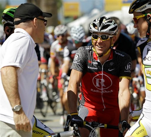Cyclists Lance Armstrong, center, smiles before the fourth stage of the Tour of California cycling race Wednesday, May 19, 2010, in San Jose, Calif. (AP Photo/Marcio Jose Sanchez)