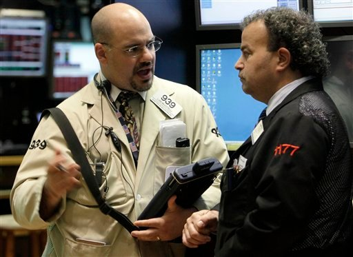 Traders Luigi Muccitelli, left, and Gerard Farco on the floor of the New York Stock Exchange, Thursday, May 20, 2010, in New York. (AP Photo/Richard Drew)