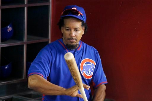 Chicago Cubs hitting consultant Manny Ramirez checks out a baseball bat in the dugout prior to a baseball game against the Arizona Diamondbacks Thursday, April 7, 2016, in Phoenix.