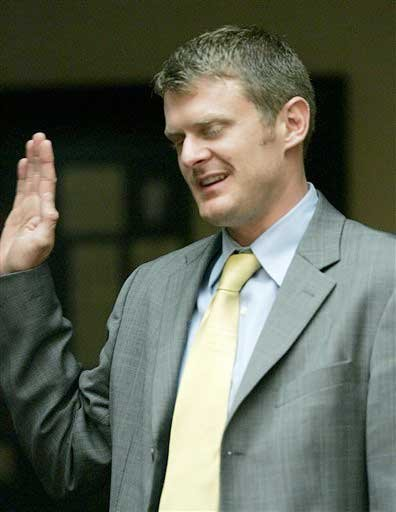 This May 19, 2007, file photo shows 2006 Tour de France cycling champion Floyd Landis being sworn in during an arbitration hearing on the doping allegations against him, at Pepperdine University in Malibu, Calif.