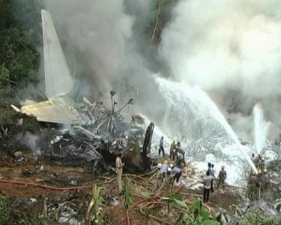 In this frame grab made off TV9 video, firefighters try to douse flames on an Air India plane that crashed in Mangalore, in the southern Indian state of Karnataka, Saturday, May 22, 2010.