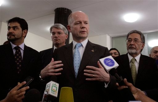 Foreign Secretary William Hague, center, and International Development Secretary Andrew Mitchell, second left, address the press along with Afghan Foreign Minister Zalmai Rasoul, right, in Kabul, Afghanistan, Saturday, May 22, 2010.  (AP Photo)