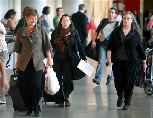 From left, Laura Fattal, Cindy Hickey and Nora Shourd walk through the terminal after their arrival at John F. Kennedy International Airport Saturday, May 22, 2010 in the Queens borough of New York. (AP Photo/Jason DeCrow)