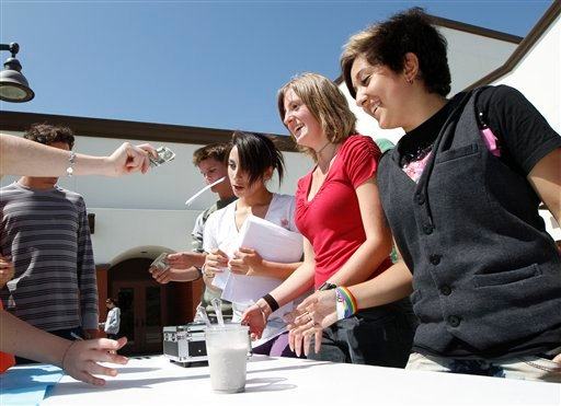 "Benji Delgadillo, right, sells ""Harvey Milkshakes"" with others in front of San Juan Hills High School Friday, May 21, 2010 in San Juan Capistrano, Calif. (AP Photo/Gregory Bull)"