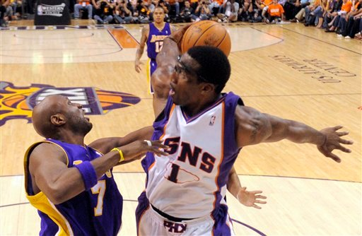 Phoenix Suns forward Amare Stoudemire, right, passes behind his back as Los Angeles Lakers forward Lamar Odom looks on during the second half of Game 3. (AP Photo/Chris Carlson)