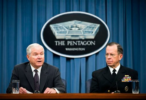 In this Feb. 1, 2010 file photo, Defense Secretary Robert Gates, left, and Joint Chiefs Chairman Adm. Mike Mullen hold a briefing at the Pentagon.