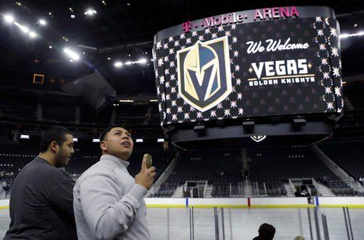 People tour T-Mobile Arena during an event to unveil the name of Las Vegas' National Hockey League franchise, Tuesday, Nov. 22, 2016, in Las Vegas.