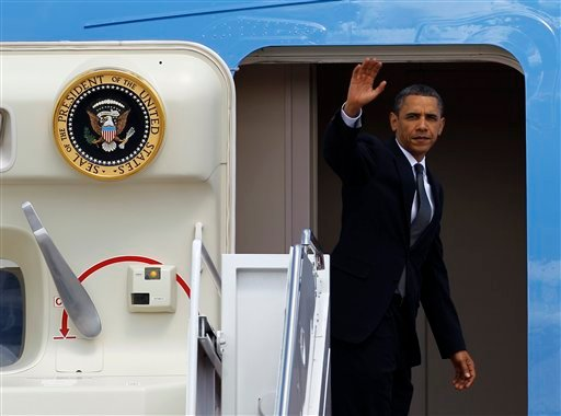 President Barack Obama waves while boarding Air Force One at Andrews Air Force Base, Md., Tuesday, May 25, 2010, before departing for California. (AP Photo/Ann Heisenfelt)