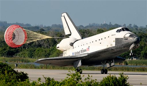 The space shuttle Atlantis lands on Kennedy Space Center's runway 33 Wednesday, May 26, 2010, in Cape Canaveral, Fla. (AP Photo/ Joe Skipper, Pool)