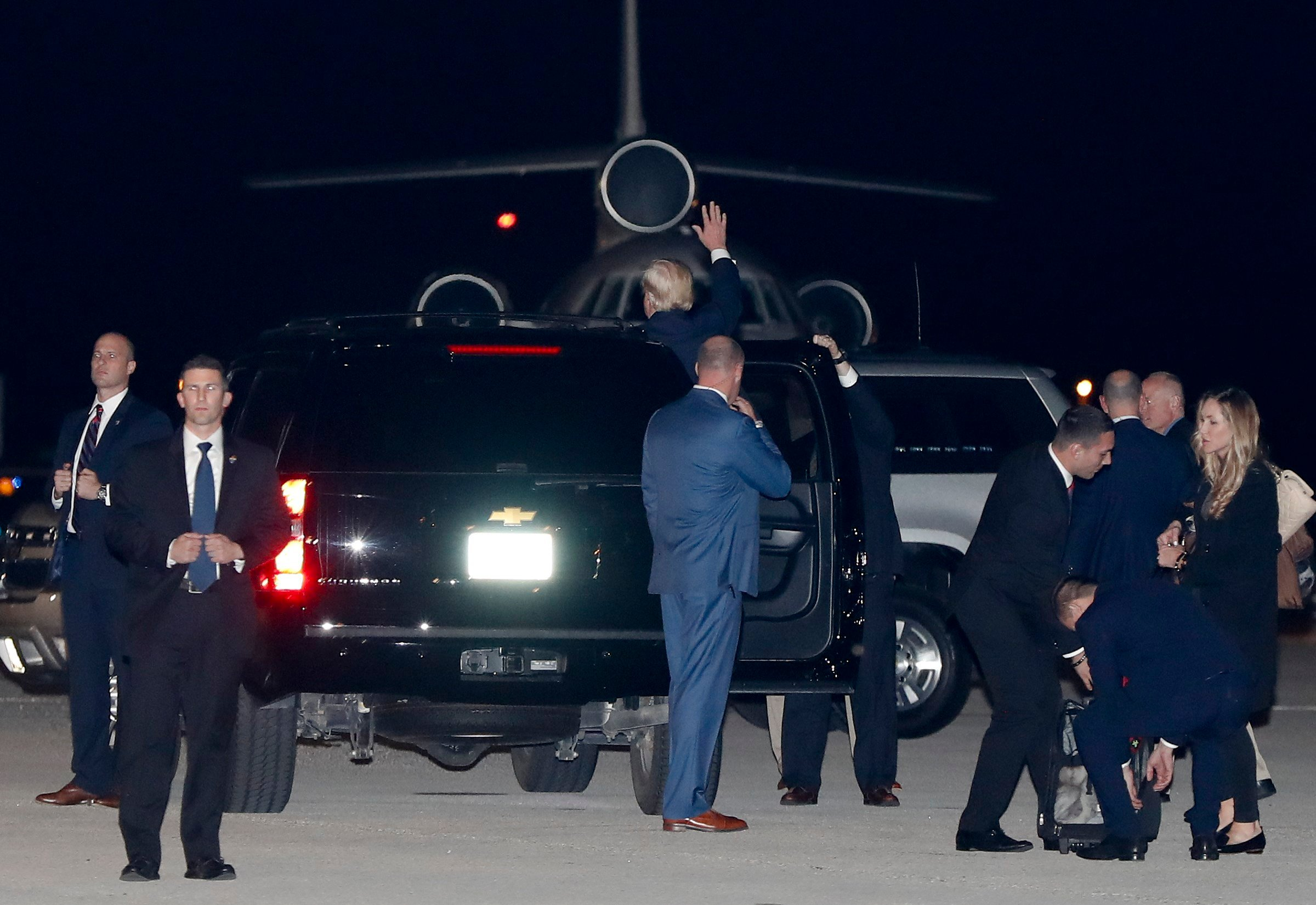 President-elect Trump waves from his motorcade vehicle on the tarmac at Palm Beach International Airport Nov. 22, 2016, in West Palm Beach, Fla., as he arrives from New York, en route to his Mar-a-Lago resort for Thanksgiving. (AP Photo/Carolyn Kaster)