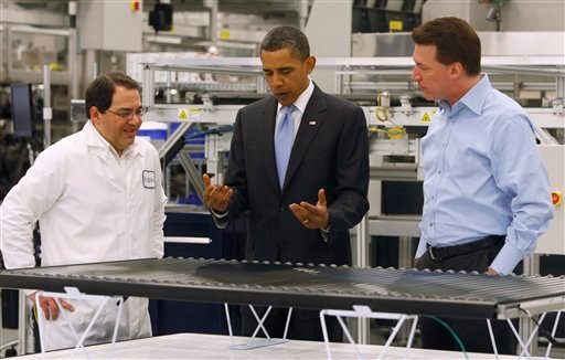 President Obama looks at a solar panel as he is given a tour of Solyndra by Executive Vice President Ben Bierman, left, and Chief Executive Officer Chris Gronet, Wednesday, May 26, 2010, at Solyndra Inc. in Fremont, Calif.