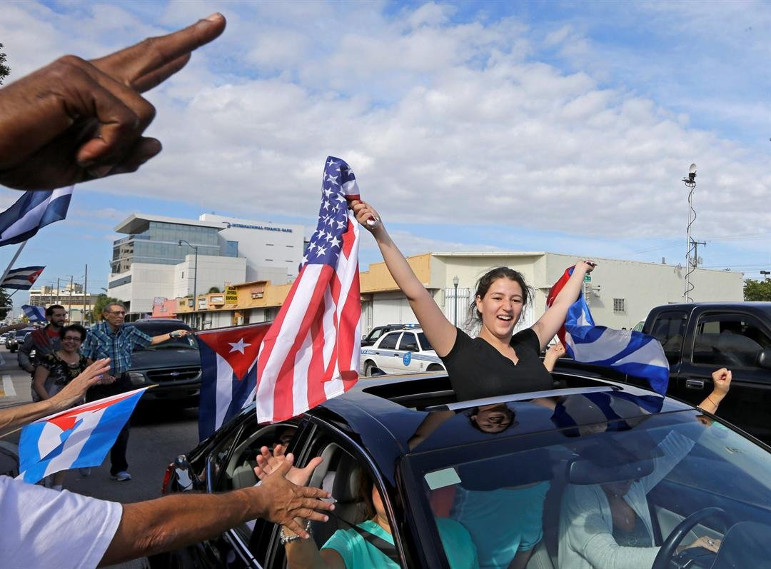 Cuban-Americans react to the death of Fidel Castro, Saturday, Nov. 26, 2016, in the Little Havana area in Miami. (AP Photo/Alan Diaz)