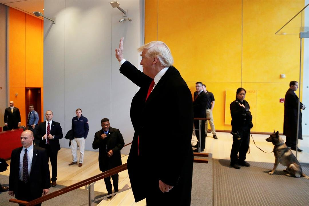 President-elect Donald Trump waves to a crowd in the lobby of the New York Times building following a meeting, Tuesday, Nov. 22, 2016, in New York. (AP Photo/Mark Lennihan)