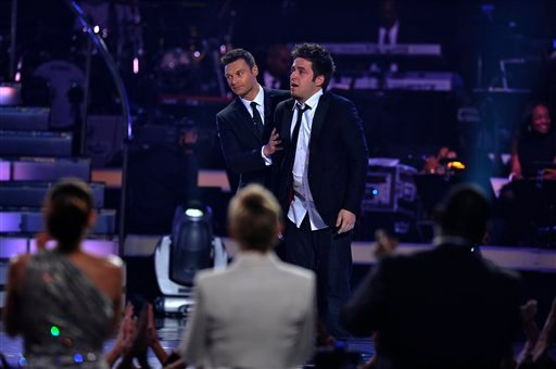 "In this publicity image released by Fox, Lee DeWyze reacts after he was announced the season nine winner during the ""American Idol"" finale at the Nokia Theatre in Los Angeles, Wednesday, May 26, 2010. (AP Photo/FOX, Vince Bucci)"