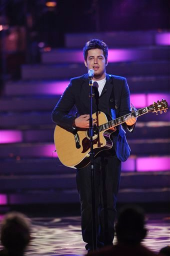 In this photo provided by PictureGroup, from left, contestant Lee DeWyze performs at the American Idol Season 9 Top 2 Performance Show at the Nokia Theatre on May 25, 2010 in Los Angeles. (AP Photo/Michael Becker/FOX/PictureGroup)