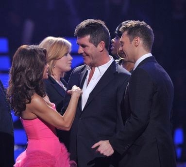 In this publicity image released by Fox, former Idol judge Paula Abdul returns to say goodbye to Simon Cowell during the 'American Idol' finale at the Nokia Theatre in Los Angeles, Wednesday, May 26, 2010.