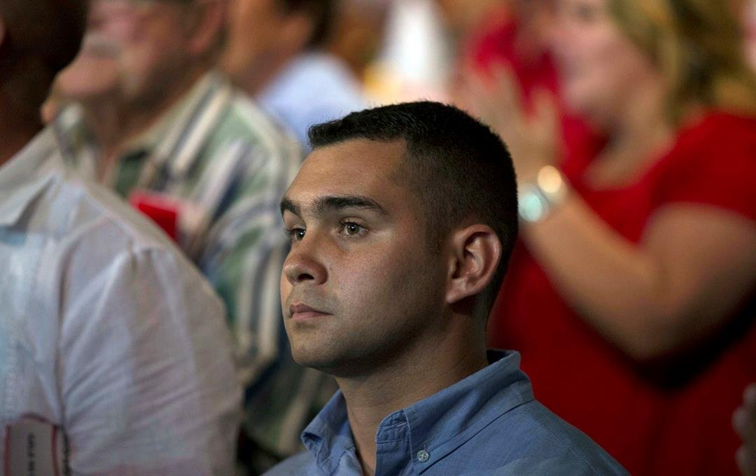 Elian Gonzalez, the young Cuban rafter who was at the center of a bitter custody battle in 2000 between relatives in Miami and his father in Cuba, attends a gala for the 90th birthday of Cuban Leader Fidel Castro at the 'Karl Marx' theater in Havana, Cuba
