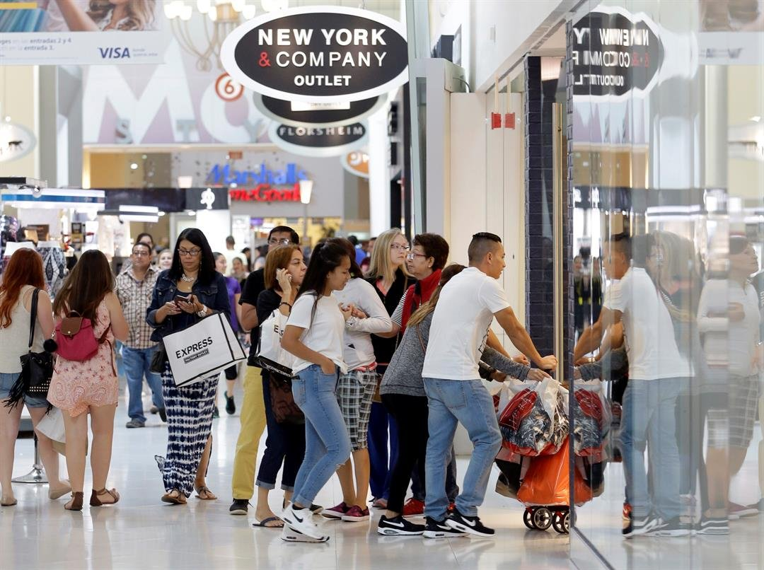Shoppers shop at the Dolphin Mall on Black Friday, Nov. 25, 2016, in Miami. Stores open their doors Friday for what is still one of the busiest days of the year, even as the start of the holiday season edges ever earlier. (AP Photo/Alan Diaz)