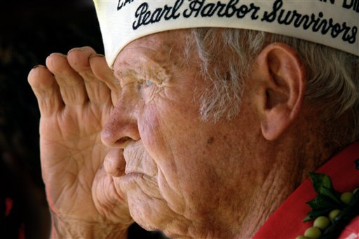 In this Dec. 7, 2006 file photo, John Finn, a Medal of Honor recipient for his actions during the Japanese attack on Pearl Harbor, salutes at the ground breaking ceremony for the USS Oklahoma memorial on Ford Island in Pearl Harbor, Hawaii.