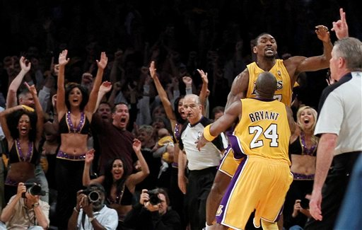 Los Angeles Lakers guard Kobe Bryant hugs forward Ron Artest after Artest's last-second basket that gave the Lakers a 103-101 win over the Phoenix Suns in Game 5 of the NBA basketball Western Conference finals. (AP Photo / Chris Carlson)