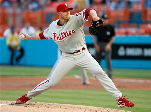 Philadelphia Phillies' Roy Halladay delivers a pitch during the first inning of a baseball game against the Florida Marlins, Saturday, May 29, 2010, in Miami. (AP Photo/Wilfredo Lee)