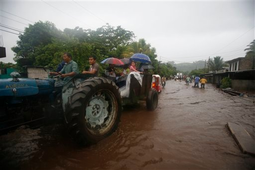 A truck evacuates residents during heavy rains caused by tropical storm Agatha in Patulul, Guatemala, Saturday, May 29, 2010. (AP Photo/Moises Castillo)