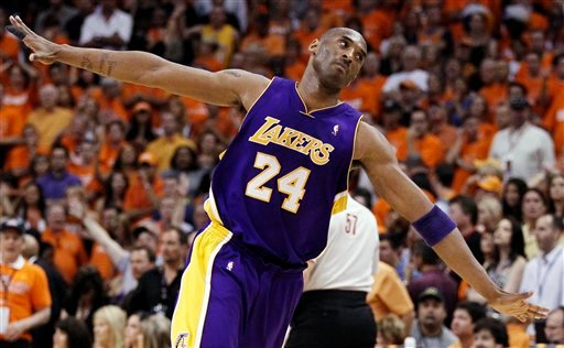Los Angeles Lakers guard Kobe Bryant makes his way downcourt after scoring against the Phoenix Suns during the second half of Game 6 of the NBA basketball Western Conference finals Saturday, May 29, 2010, in Phoenix. (AP Photo/Chris Carlson)