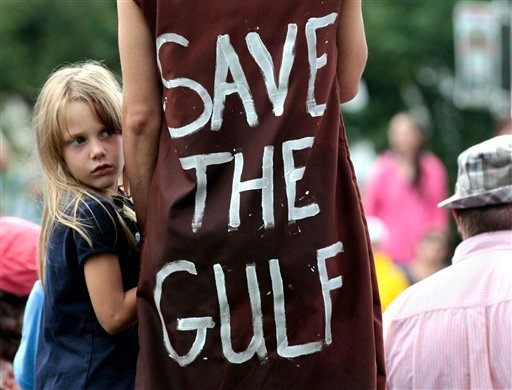 Jolie Van Gilder, left, holds her mother's hand during a rally against BP PLC and the Gulf oil spill, in New Orleans, Sunday, May 30, 2010. (AP Photo/Jae C. Hong)