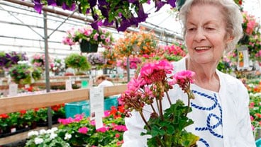 Cynthia Bryant, 73, looks for a plant in a green house near her home in Denver, Friday, May 27, 2010. Bryant, like many Americans, still feel stressed out by debt, despite the economic recovery. (AP Photo/Ed Andrieski)