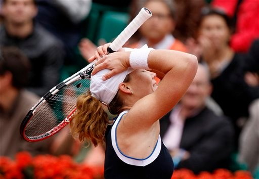 Australia's Samantha Stosur reacts after defeating Belgium's Justine Henin during their fourth round match for the French Open tennis tournament at the Roland Garros stadium in Paris, Monday, May 31, 2010. (AP Photo/Michel Euler)