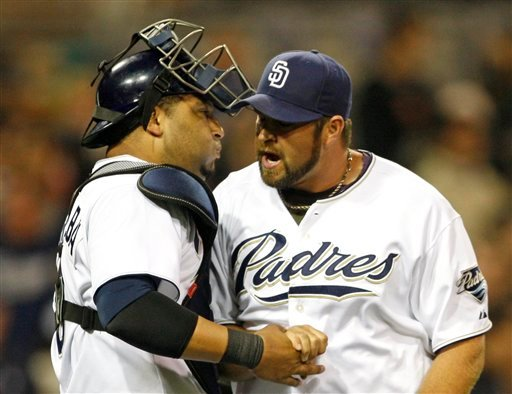San Diego Padres closer Heath Bell and catcher Yorvit Torrealba celebrate the Padres 3-1 victory over the San Francisco Giants in a baseball game Monday May 17, 2010 in San Diego. (AP Photo/Lenny Ignelzi)
