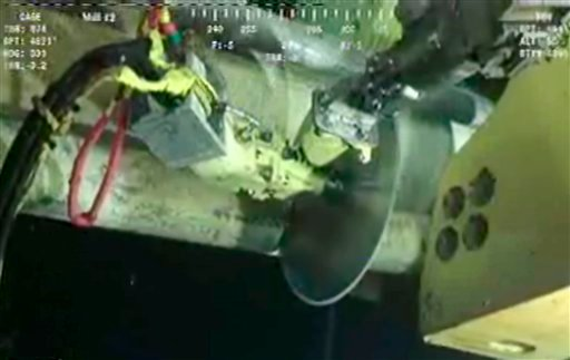 In image made from video released by British Petroleum (BP PLC), robot submarines use a circular saw-like device to cut a pipe at the Deepwater Horizon oil rig June 1, 2010. (AP Photo/BP PLC)