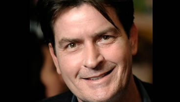 FILE - This Jan. 28, 2009 file photo shows Charlie Sheen in Los Angeles. Sheen has reached an agreement with authorities in Colorado over domestic violence allegations involving his wife, a prosecutor said Tuesday, June 1, 2010.