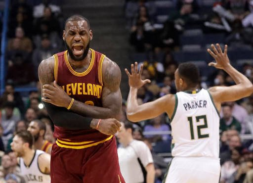 Cleveland Cavaliers' LeBron James reacts to no call being called on his shot during the second half of an NBA basketball game against the Milwaukee Bucks Tuesday, Nov. 29, 2016, in Milwaukee.