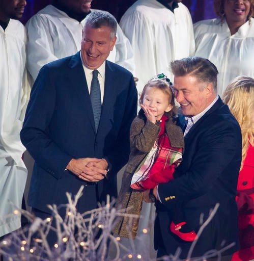 Mayor Bill de Blasio, left, Carmen Baldwin and Alec Baldwin attend the 84th Annual Rockefeller Center Christmas Tree lighting ceremony on Wednesday, Nov. 30, 2016, in New York.