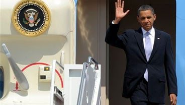 President Barack Obama waves as he walks off of Air Force One at Andrews Air Force Base in Md., Wednesday, June 2, 2010, after a trip to Pittsburgh. (AP Photo/Susan Walsh)