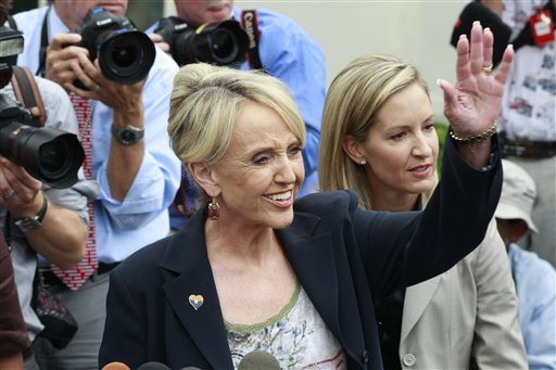 Arizona Gov. Jan Brewer waves as she speaks to reporters outside the White House in Washington, Thursday, June 3, 2010, after a private meeting with President Barack Obama. (AP Photo/Charles Dharapak)